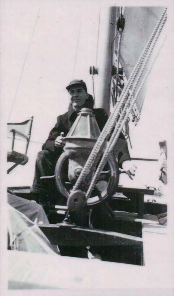 """Nelson H White at the helm of the """"Tabor Boy"""", Tabor Academy"""
